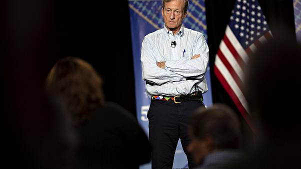 Image: Tom Steyer listens during a town hall event in Ankeny, Iowa, on Jan.