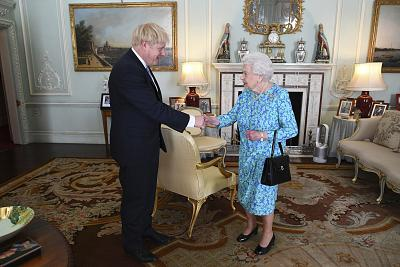 Queen Elizabeth II welcomes newly elected leader of the Conservative Party Boris Johnson at Buckingham Palace on July 24.