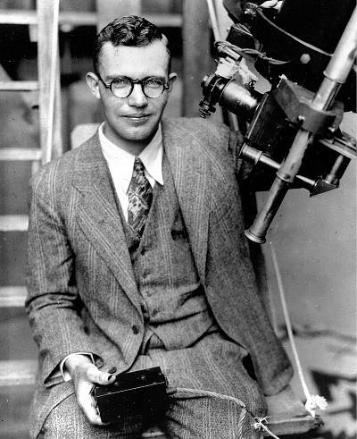 Clyde Tombaugh poses with the telescope through which he discovered the Pluto at the Lowell Observatory on Observatory Hill in Flagstaff, Ariz. in 1931.