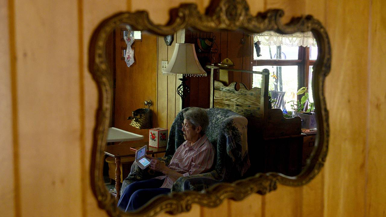 Image: Audrey Buchanan, 88, is reflected in a mirror while she plays Animal