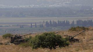 Image: Israeli self-propelled artillery guns are positioned near the Lebane