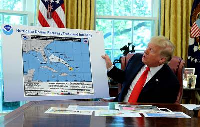 President Donald Trump holds an early projection map of Hurricane Dorian in the Oval Office on Sept. 4, 2019.