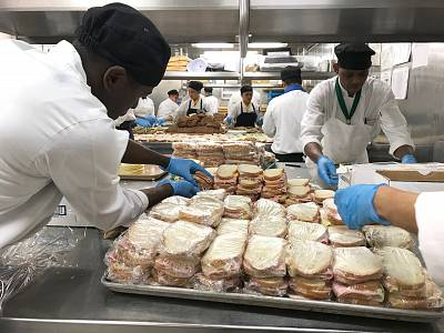 Celebrity Equinox kitchen staff work overtime to prepare over 10,000 meals that will be brought to people in need in Freeport, Bahamas. The cruise ship has been rerouted from Nassau to provide relief to the island hit by Hurricane Dorian.