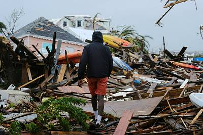 A man walks through the rubble in the aftermath of Hurricane Dorian on the Great Abaco island town of Marsh Harbour, Bahamas, on Sept. 2.