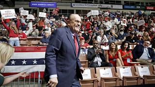 Image: Former New York City Mayor Rudy Giuliani smiles as he arrives to Pre