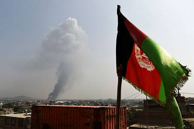 Smoke rises from the site of an attack after a massive explosion the night before near the Green Village in Kabul on Sept. 3, 2019.