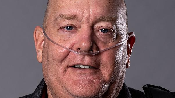 Shows Tom Frey, a retired NYPD detective who became sick after helping in t