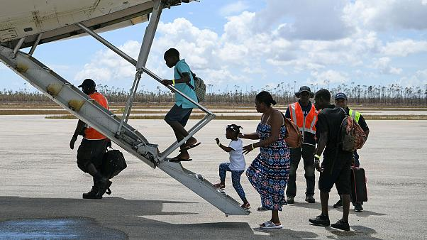 Image: Abaco residents are evacuated from the island at the airport in the