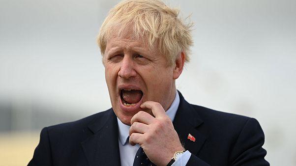 Image: Britain's Prime Minister Boris Johnson visits the NLV Pharos, a ligh