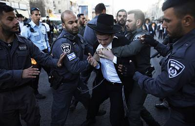 Police detain ultra-Orthodox Jews during a protest against Israeli army conscription in Jerusalem on April 3, 2017.