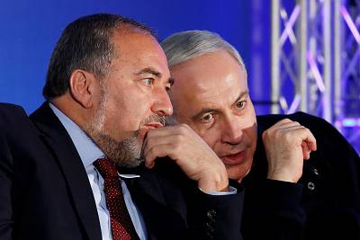 Israel\'s Prime Minister Benjamin Netanyahu with former Foreign Minister Avigdor Lieberman during a Likud-Yisrael Beitenu campaign rally in the southern Israeli city of Ashdod on Jan. 16, 2013.