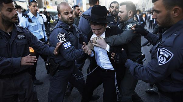 Image: Police detain ultra-Orthodox Jews during a protest against Israeli a