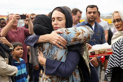 Prime Minister Jacinda Ardern hugs a mourner at the Kilbirnie Mosque on March 17, 2019, in Wellington, New Zealand.
