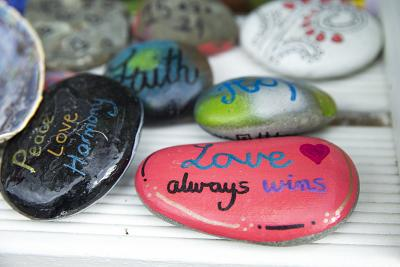 Messages of support are painted on rocks outside the gates of Al Noor Mosque.