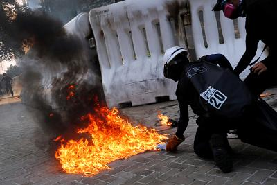 An anti-government protester prepares to throw a Molotov cocktail during a demonstration in Hong Kong, China on Sunday.