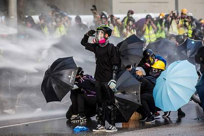 Protesters react as police fire water cannons outside the government headquarters in Hong Kong on Sunday.