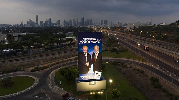 Image: A massive election campaign billboard of the Likud party shows Israe