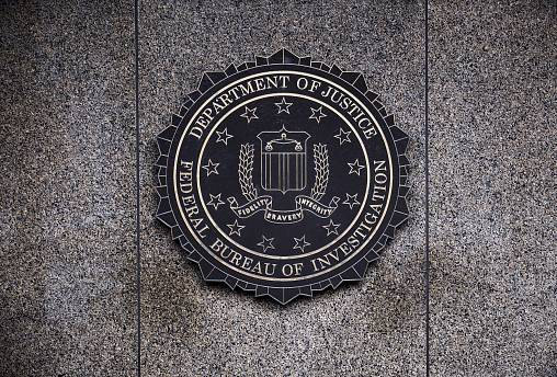 Image: The Federal Bureau of Investigation seal is displayed outside FBI he