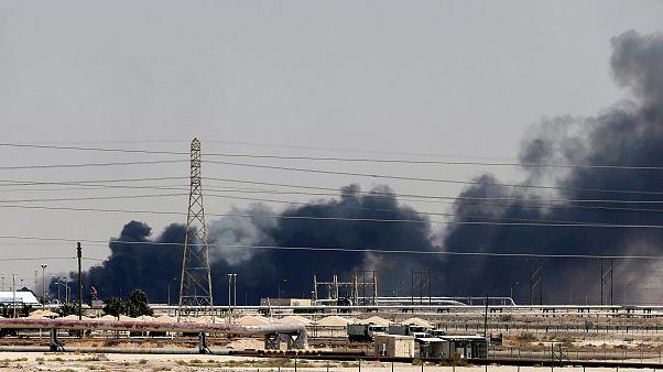 Image: Smoke rises following a fire at the Aramco facility in Saudi Arabia