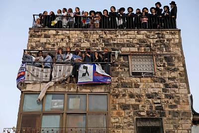 Ultra Orthodox Jews stand on the roof of a building during an election campaign rally of the United Torah Judaism at the center of Jerusalem on Sept. 15 2019, two days ahead of the Israeli general elections.