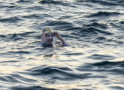 Sarah Thomas became the first person to swim across the English Channel four consecutive times on Tuesday.
