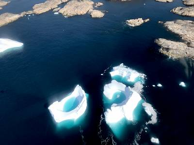 We flew over these icebergs on the way to Helheim Glacier.