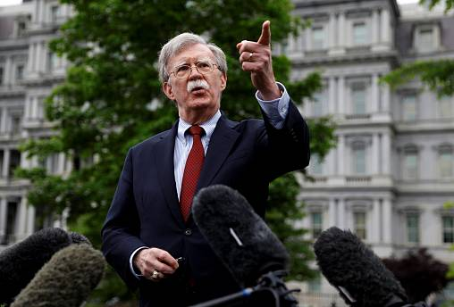 Image: National Security Adviser John Bolton speaks to reporters at the Whi