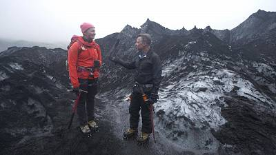 Richard Engel and Sigurros Arnardottir, a masters student in glacial geology at the University of Iceland, atop the Solheimajokull Glacier in Iceland.