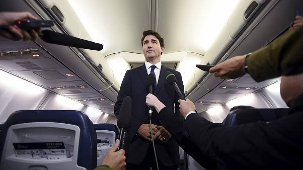 Image: Canadian Prime Minister Justin Trudeau speaks to reporters on his ca