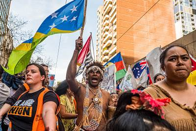 A man wearing the traditional dress of the Solomon Islands march on Sept. 20, 2019 in Melbourne, Australia.