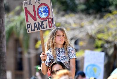 A young protester takes part in The Global Strike 4 Climate rally in Brisbane, Australia
