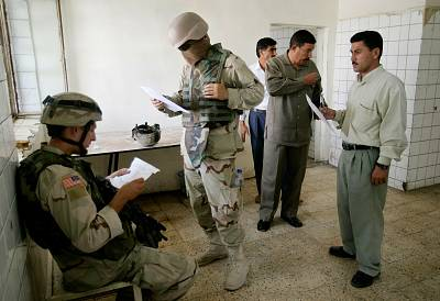 An interpreter, center, works during a patrol in Arij, near Mosul, Iraq, on July 24, 2005.