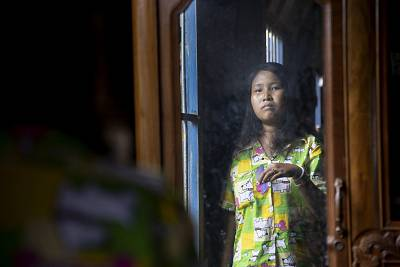 Lang Heang Khim, 22, brushes her hair at her home in the village of Chong Trek in Cambodia\'s Kampong Cham province.