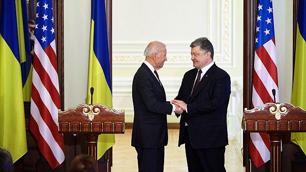 IMage: Vice President Joe Biden shakes hands with Ukranian President Petro