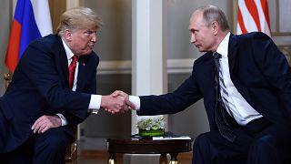 Image: Russian President Vladimir Putin and President Donald Trump shake ha