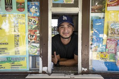 Orlando Enrique, 28, has worked at the concession stand in Salt Lake Park for nine years. He said people started acting differently when the robot began its patrol.