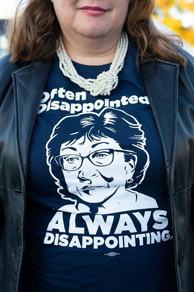 Diane Russell, a former state legislator, wears a shirt critical of Sen. Susan Collins.