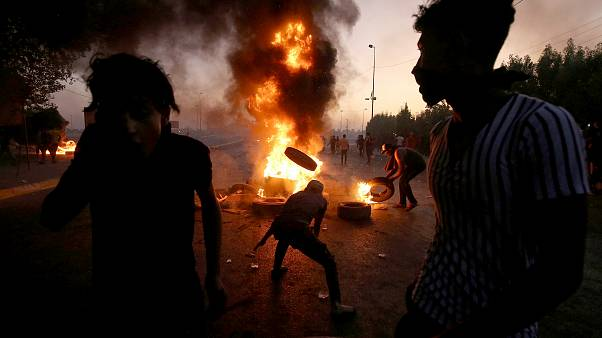 Image: TProtesters burn tires during a demonstration in Baghdad, Iraq, on O