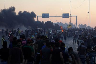 Demonstrators gather at a protest after the lifting of the curfew, following four days of nationwide anti-government protests that turned violent, in Baghdad, Iraq on Oct. 5, 2019.