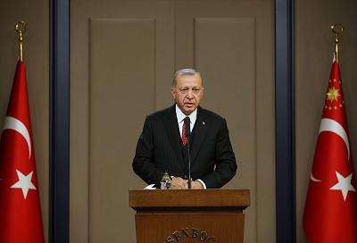 Turkish President Tayyip Erdogan speaks at Esenboga Airport in Ankara, Turkey, Oct. 7, 2019