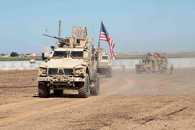 U.S. and Turkish military forces conduct a joint ground patrol inside the security mechanism area in northeast, Syria, on Sept. 8, 2019.