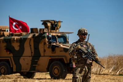 A U.S. soldier stands guard during a joint patrol with Turkish troops in the Syrian village of al-Hashisha along the border with Turkey, on Sept. 8, 2019.