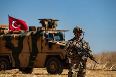 A U.S. soldier stands guard during a joint patrol with Turkish troops in the Syrian village of al-Hashisha along the border with Turkey, on Sept. 8.