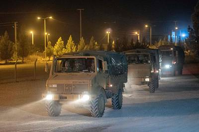 Turkish soldiers drive towards the border with Syria near Akcakale in Sanliurfa province on Tuesday.