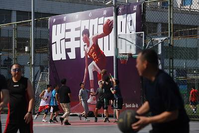 People play basketball at an outdoor court in Beijing on Wednesday.