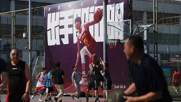 Image: People play basketball at an outdoor court in Beijing on Oct. 9, 201