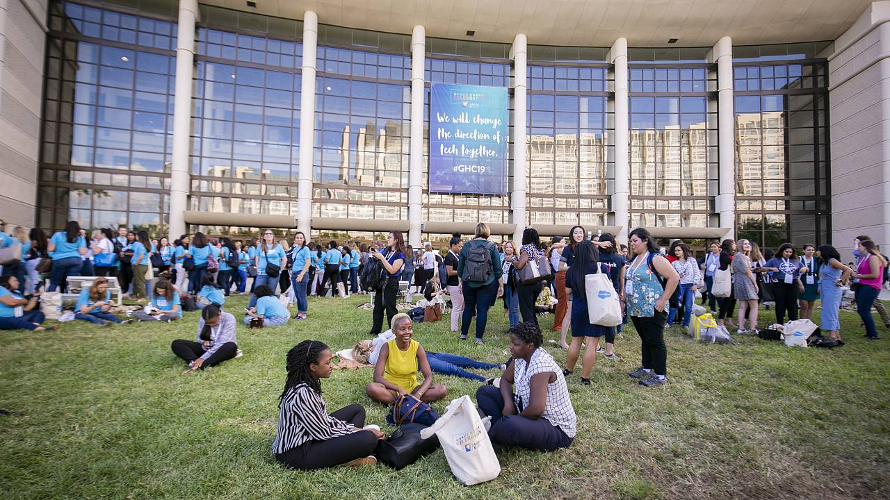 Attendees enjoy a break outside the convention center where the Grace Hoppe