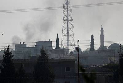 Smoke rises over the Syrian town of Ras al-Ain, as seen from the Turkish border town of Ceylanpinar, Sanliurfa province, Turkey, on Thursday.