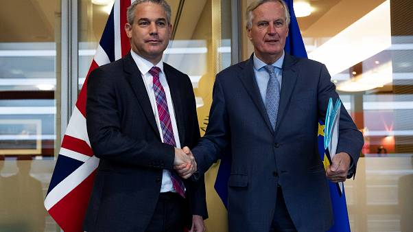 Britain's Brexit Secretary Barclay poses with EU's chief Brexit negotiator