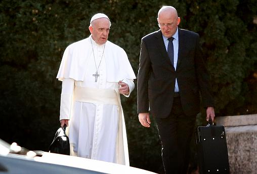 Image: Pope Francis walks with head of security Domenico Giani near Rome on